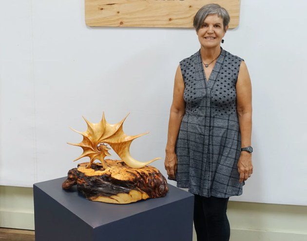Wootha Prize coordinator Corrie Wright stands with the 2019 exhibition installation.