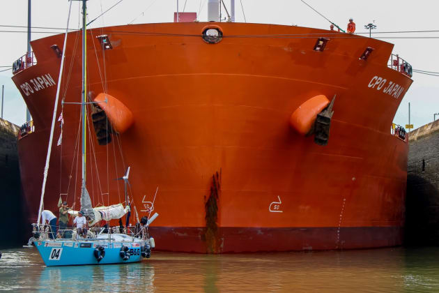 Perie Banou II dwarfed by a ship in the Panama Canal. Photo Paul & Steven Stratfold.