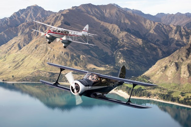 A De Havilland Dominie and Beech Staggerwing in formation over Lake Wanaka. (Phil Hosking)
