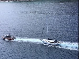 Coast Guard responds to explosion and rescues two from a sinking sail boat.