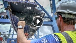 Neil Cox loads Team Vestas Wind onto a ship in Malaysia