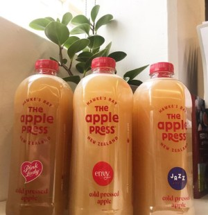 Cold-pressed apple juice crosses the ditch
