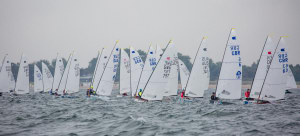 Andre Budzien takes narrow lead at OK Dinghy worlds after damp day in Warnemünde