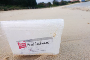 Coles packaging washes ashore after cargo incident