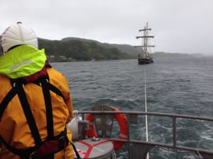 Passenger's mistake causes tall ship to be towed by lifeboat