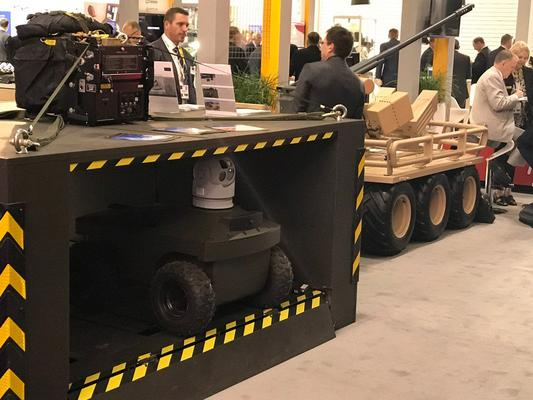 Praesidium Global's air deployable UGV solution Pathfinder and the Mission Adaptable Platform System (MAPS) at the DSEI event as part of Team Defence Australia. Credit: @Praesidium_info via Twitter