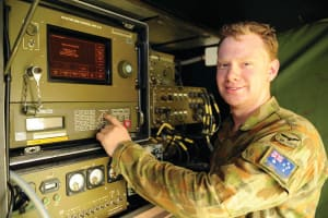 Satellite technician, Leading Aircraftman Chris Bennett, works on a data link to Australia whilst deployed on Operation PAKISTAN ASSIST II. Credit: Defence