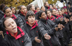 The Gondwana National Indigenous Children's Choir, conducted by Lyn Williams, OAM open the 2014 Defence NAIDOC Ceremony held at the Australian War Memorial, Canberra.