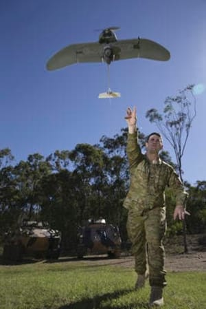 A soldier from 2nd/14th Light Horse Regiment launches a Wasp AE small unmanned aircraft vehicle at Gallipoli Barracks in Brisbane. Credit: Defence