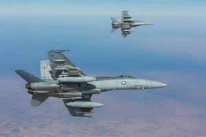 A pair of F/A-18A Hornets from Air Task Group 630 Strike Element flying in the Middle East Region during an Operation Okra mission. Credit: Defence