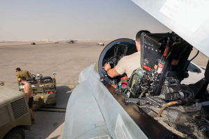 Armament Technician with the Air Task Unit Strike Element, Leading Aircraftman Braedon Meakin configures the weapon load in the cockpit of an F/A-18A Hornet at Australia's main operating air base in the Middle East Region. Credit: Defence