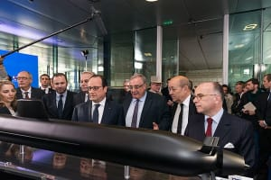 At the announcement of the DCNS (now Naval Group) contract win for Sea 1000, a model of the Shortfin Barracuda design is shown to then French President Francois Hollande. Marie-Pierre de Bailliencourt is on the left, with Herve Guillou third from right. Credit: Naval Group