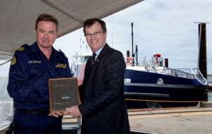 Davyd Thomas, Austal Vice President Defence, presents Cape Nelson CO Tim Spencer the Builders Plaque.