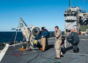 Insitu and Boeing contractors prepare a ScanEagle for a test flight. Credit: USN