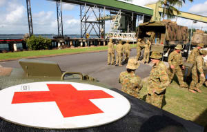 Members of 1st Close Support Battalion unload supplies and equipment to establish a field hospital at Mourilyan harbour during the first stage of phase three of Exercise Sea Dawn 2014. Credit: Defence