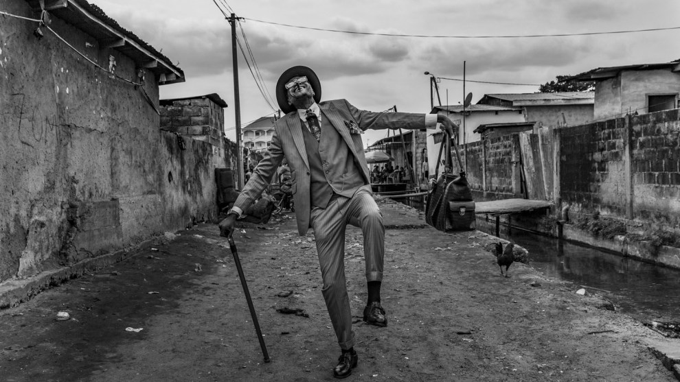 Tariq Zaidi, UK, Highly commended, faces, people, cultures portfolio. Brazzaville, Republic of the Congo. Elie, 45, struts his stuff in the streets of Brazzaville. He has been a Sapeur for 35