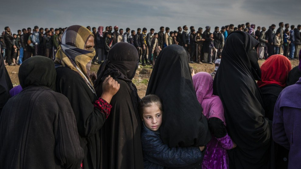 The Battle for Mosul. World Press Photo of the Year Nominee. © Ivor Prickett. Civilians who had remained in west Mosul after the battle to take the city line up for aid in the Mamun neighbourhood. 