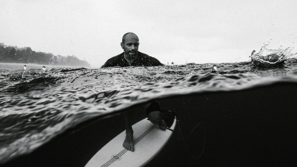 Russell Ord, Tom Carroll, Tropical Rain.	Tom Carroll portrait in the tropical rain Indonesia.