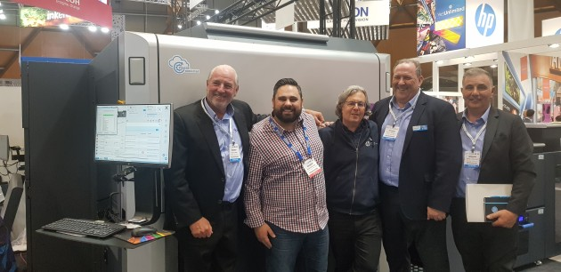 At PrintEx last year as Courtney Colour signs for HP Indigo: (l-r) David Currie, Aldo Burcheri, Alon Bar-Shany, Phil Rennell and Vince Pignataro.