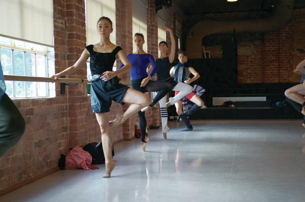 Reika Sato (front) and dancers in West Australian Ballet company Class. Photo: Tony Currie.