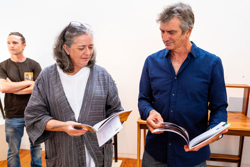 SWA members Ruth Thompson and Tony Kenway peruse the catalogue which accompanies the exhibition. Photo: Julijana Griffiths