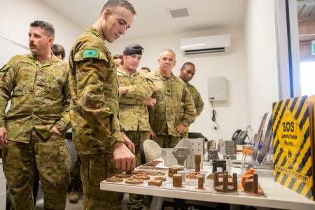 Australian Army soldiers check out the parts created using 3D printing technology. (CDU)