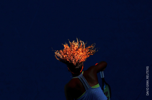Sunlight Serve © David Gray, Reuters. Naomi Osaka serves during her match against Simona Halep from Romania during the Australian Open tennis tournament, at Margaret Court Arena, Melbourne, Australia, on 22 January.