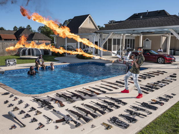 The 'Ameriguns'. © Gabriele Galimberti, Italy, for National Geographic. Torrell Jasper (35) poses with his firearms in the backyard of his house in Schriever, Louisiana, USA, on 14 April 2019. A former US Marine, he learned to shoot from his father as a child. According to the Small Arms Survey– an independent global research project based in Geneva, Switzerland–half of all the firearms owned by private citizens in the world, for non-military purposes, are in the USA. The survey states that the number of firearms exceeds the country's population: 393 million guns to 328 million people.