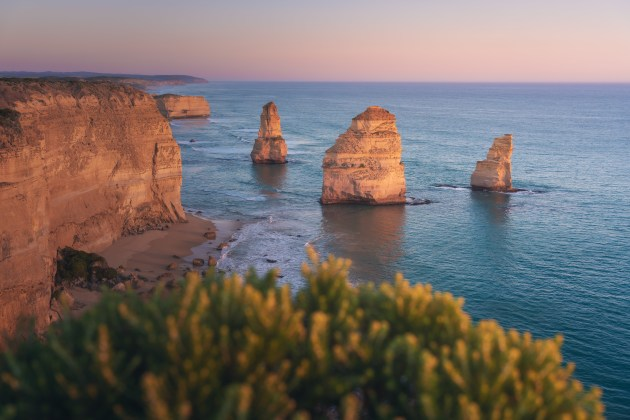 The Twelve Apostles: A less-photographed view of Victoria's Twelve Apostles as last light ignites the sea stacks. As landscape photographers we often seek tack-sharp images front to back, but sometimes a soft foreground or background helps draw more attention to the main subjects. Sony A7R Mark III, 24-70mm f/2.8 lens @ 38mm. 1/200s @ f3.5, ISO 160.