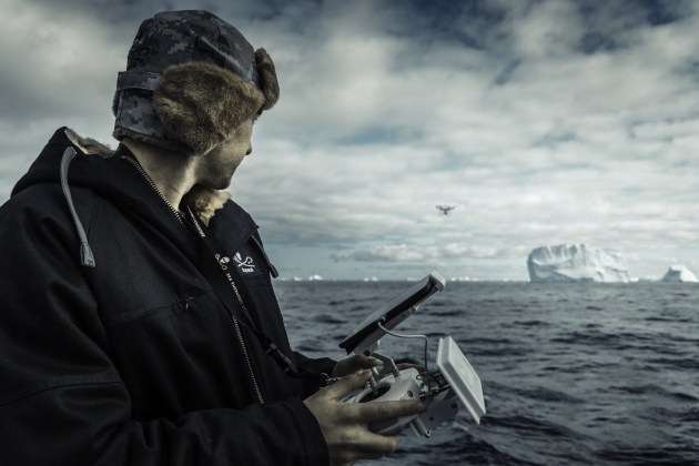 © Simon Ager. Gavin Garrison flies a drone over the Cooperation Sea, Antarctica, while filming for the TV series, Whale Wars.