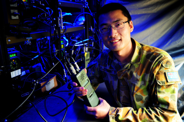 A telecommunications systems technician from the 7CSR with a Harris software defined radio delivered under earlier phases of the broad Land 200 Battlespace Communications program. Credit: Defence