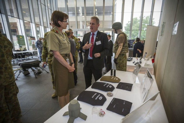 A DefendTex representative talks to Head of Land Capability MAJGEN Kathryn Toohey at Army Innovation Day 2017. Credit: Defence