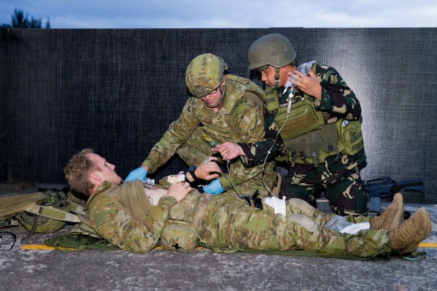 Caption: Australian Army soldier Corporal David Bell from Joint Task Group 629 and a Philippines Army soldier provide medical care to a casualty during an urban combat skills demonstration at the Armed Forces of the Philippines Headquarters in Manila, Philippines.