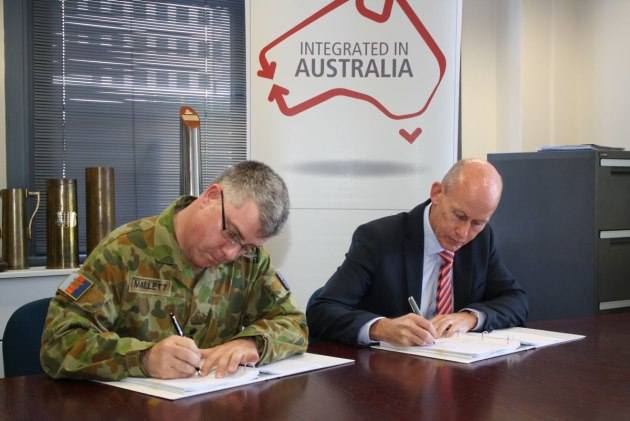 Colonel Doug Mallett, Director Combat Support Systems Program Office, Department of Defence and Mr Jim Gardener, General Manager, Joint Battlespace Systems, Raytheon Australia, sign a contract for the Short Range Ground Based Air Defence project Risk Mitigation Activity at Victoria Barracks Melbourne. Credit: Defence