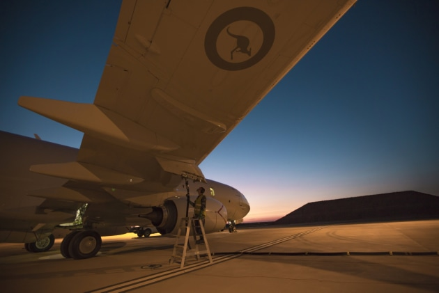Dawn breaks as fuel is taken on-board a No. 11 Squadron P-8A Poseidon. Defence