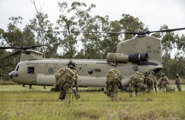 Australian Army soldiers of the 8th/9th Battalion, the Royal Australian Regiment, board a CH-47 Chinook during a non-combatant evacuation operation at Shoalwater Bay. Defence