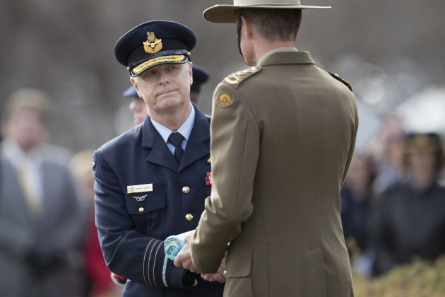 Outgoing Chief of Defence Force, Air Chief Marshal Mark Binskin, hands over the Chief of Defence Force flag to incoming Chief of Defence Force, General Angus Campbell. Defence