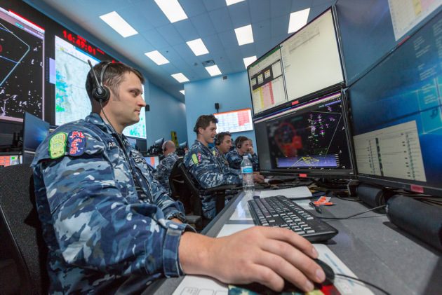 RAAF Intelligence Officer Flight Lieutenant Adam Edwards monitors screens inside the Control and Reporting Centre at the Nevada Test and Training Range facility. (Defence)
