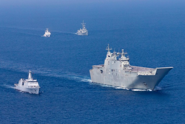 HMA ships Canberra and Newcastle sail in company with Sri Lankan Navy ships during IPE19. Credit: Defence