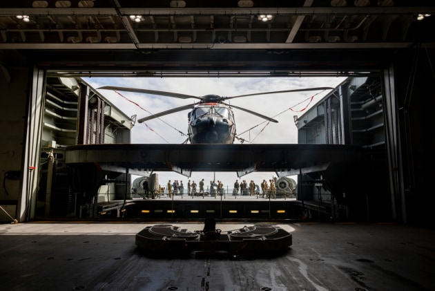 MRH-90 Multi-Role Helicopter being moved from the hangar to the flight deck onboard HMAS Canberra during Exercise Talisman Sabre. Credit: Defence