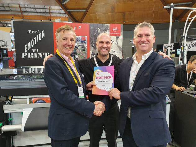 Fast and furious: Craig Nethercott (right) and Andy Cocker (centre), Océ, accept a Print21 Hot Pick from Wayne Robinson.