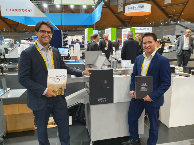 Swiss engineering: Patrick Lerch (left) from Multigraf, and Jimmy Nguyen, Neopost, with the Touchline CF-375.