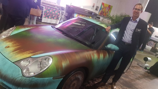 It's a wrap: Epson GM for marketing Bruce Bradley pictured with a wrapped Porsche at the launch event