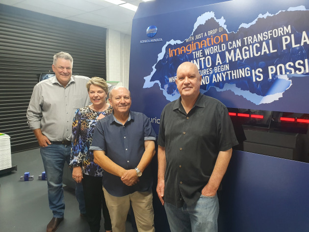 Like family: (left to right) David Procter and Sue Threlfo, Konica Minolta; Emmanuel Buhagiar, Imagination Graphics; and David Cooke, Konica Minolta, with (back) Kimmy the KM-1
