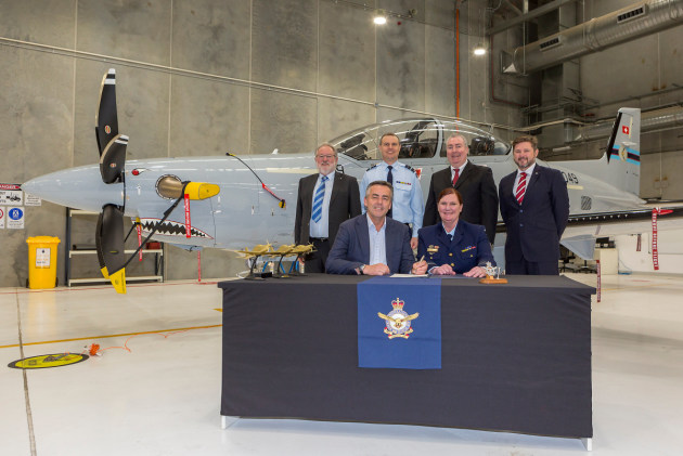Minister for Veterans and Defence Personnel Darren Chester MP (r), and Air Force officer, Head of Air Force Capability, Air Vice-Marshal Catherine Roberts, sign the Certificate of Achievement at the final delivery ceremony for the new RAAF Pilatus PC-21s. (Defence)