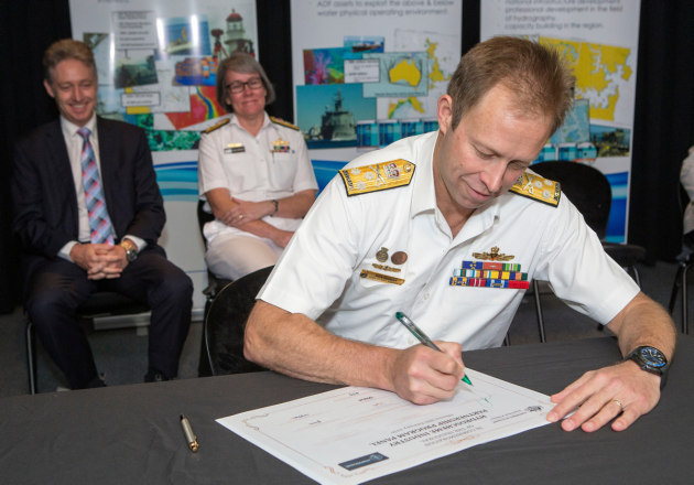 Chief of Navy, Vice Admiral Michael Noonan signs the Hydroscheme Industry Partnership Program Commemoration Certificate during a Ceremony held at Russell Offices, Canberra. (Defence)