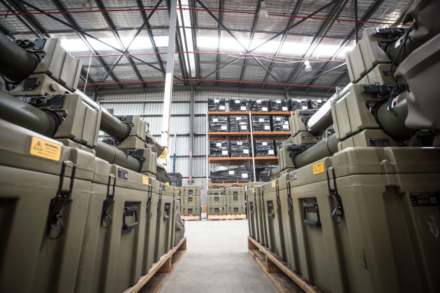 The NAM transit cases and other Project Currawong equipment await delivery in a Boeing warehouse. Credit: BDA