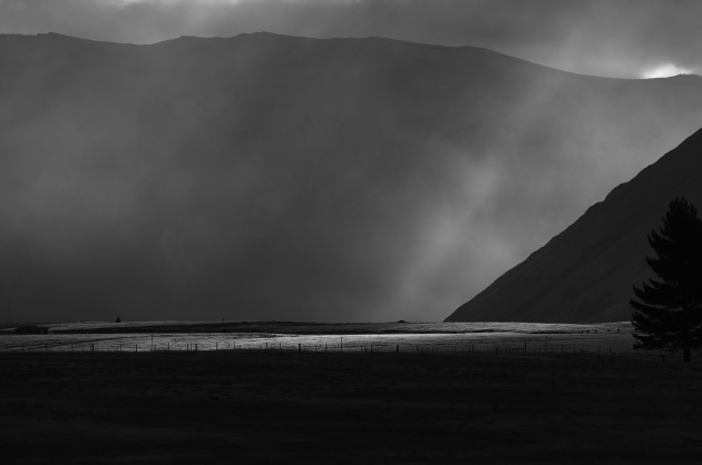 The parallel rays of sunlight that found the gaps in the cloud were the keys to making this simplistic landscape emotive. There is enough detail in the dark menacing tones to just make out the silhouette of a tree. This is compositionally balanced by the thin strip of sunlight that shines across the field. Canon EOS R, EF-100-400mm f/4.5-5.6L lens @ 340mm. 1/800s @ f10, ISO 200.