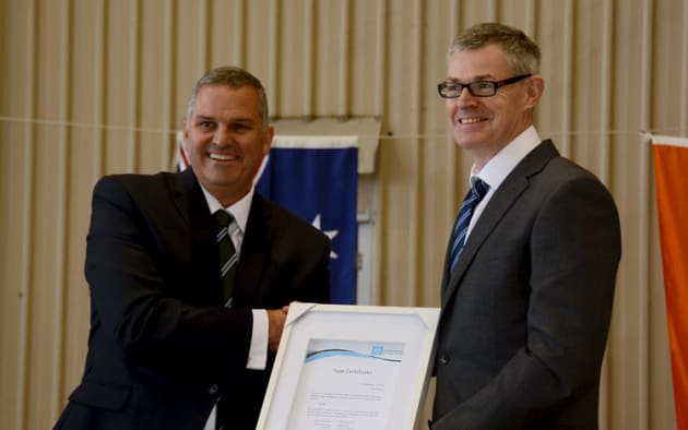 CASA Stakeholder Engagement Manager Rob Walker (left) hands the Airvan 10 type certificate to GippsAero CEO Keith Douglas. (Steve Hitchen)