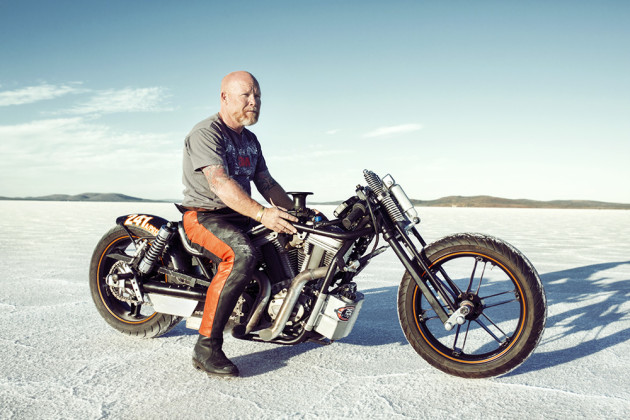 Portrait of Mick Hite on his heavily customised Harley Davidson. © Brook Ready.